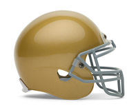 Gold Football Helmet. Side View of Gold Football Helmet with Copy Space Isolated on White Background Royalty Free Stock Photo