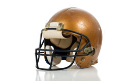 Gold football helmet on a white background Stock Photography