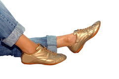 Gold footwear. On the white royalty free stock photography