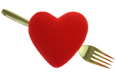 Gold fork behind red heart Royalty Free Stock Photo