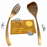 Gold fork and spoon icon with credit card Royalty Free Stock Image