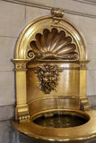 Gold fountain with devil head Royalty Free Stock Photography
