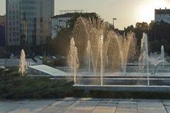 Gold fountain at last sunrays Stock Photo