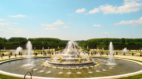 Gold fountain in Paris stock image