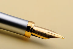 Gold fountain pen closeup Stock Photography