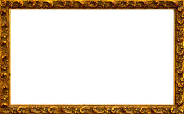 Gold frame. Antique gold picture frame border with isolated white center Royalty Free Stock Photo