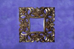 Gold frame. Classic wooden golden frame embossed in gold on a background of purple tones stock photography