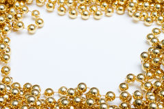 Gold frame. Made of garland beads Royalty Free Stock Photos