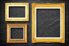 Gold frame on black slate background Stock Image