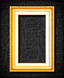Gold frame on black slate background Royalty Free Stock Photos