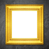 Gold frame on black slate background. Royalty Free Stock Photos