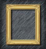 Gold frame on black slate background. Gold frame on black slate on background stock photos