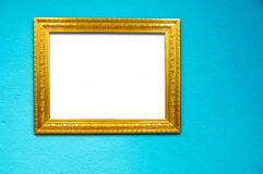 Gold frame on blue cement background Royalty Free Stock Photos