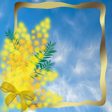Gold frame with a bouquet of mimosa Royalty Free Stock Image