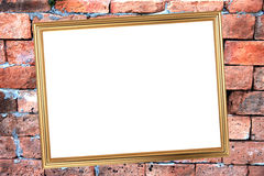 Gold frame on Brick Background of stone. Royalty Free Stock Images