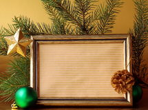 Gold frame and Christmas decorations stock photo