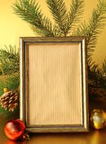 Gold frame and Christmas decorations stock image