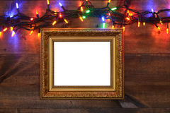 Gold frame with christmas lights Stock Photography