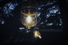 Gold Frame Clear Glass Lantern during Nighttime Stock Photography