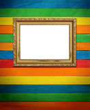 Gold frame on colorful wood Royalty Free Stock Images