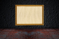 Gold frame on a concrete wall Royalty Free Stock Images