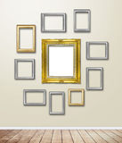 Gold Frame decor on wallpaper with light flare. Royalty Free Stock Photo