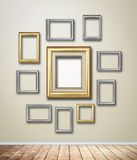 Gold Frame decor on wallpaper with light flare. Stock Photo