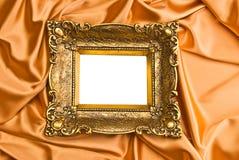 Gold Frame On Gold Satin Stock Photo