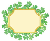 Gold frame with green shamrock - vector Stock Image
