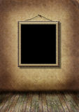 Gold frame hangs on an old wall Stock Images