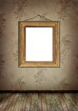 Gold frame hangs on an old wall. Royalty Free Stock Image