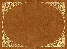 Gold frame on light-brown leather. Vintage gold stamping on leather royalty free stock image