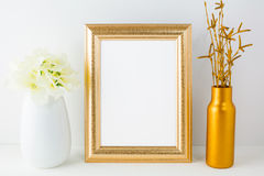 Gold frame mockup with golden vase and ivory hydrangea Royalty Free Stock Image