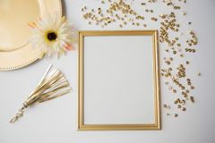 Gold frame and objects on white background stock photos