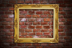 Gold frame on old brick wall Royalty Free Stock Image