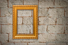 Gold frame on a old wall Stock Photo
