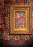 Gold frame and the old wallpaper Royalty Free Stock Photo