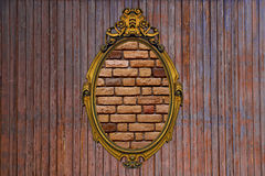 Gold frame on old wooden wall Stock Image