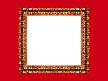 Gold frame on red background royalty free stock photos