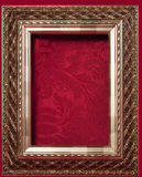 Gold Frame on a Red brocade background Stock Image