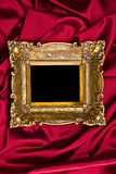 Gold Frame On Red Satin Stock Photography