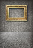 Gold frame in room. With concrete wall royalty free stock photo