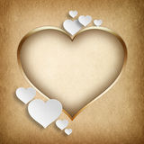 Gold frame in shape of heart and white hearts Royalty Free Stock Image