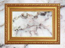 Gold frame Vintage photo frame on marble stone wall background.  stock photo
