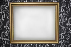 Gold frame with a white background on the wall wit Royalty Free Stock Photography