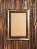 Gold frame on wood Stock Photos
