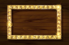 Gold frame on a wooden background Stock Images