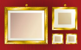 Gold frames background. Background with vintage gold frames on the vinous wallpaper Stock Photos