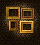 Gold frames damask wall. Four gilded frames on dark damask pattern wall paper royalty free illustration
