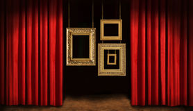Gold frames with red drapes. And dark background Stock Image